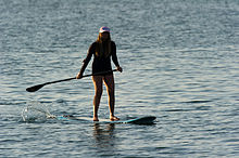 220px-Woman_stand_up_paddle_surfing