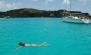 Girl snorkelling in Antigua by yacht